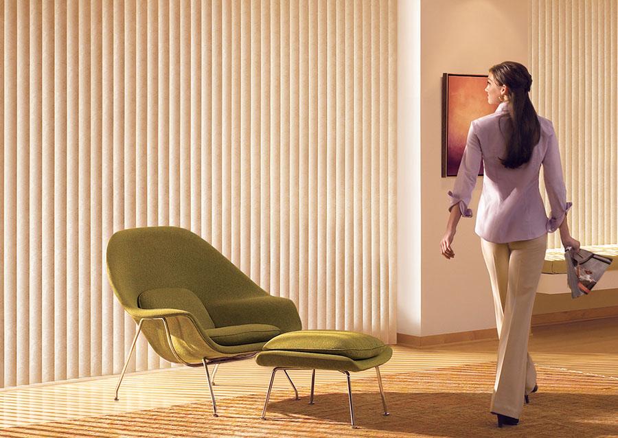 Woman-Admiring-Vertical-Blinds