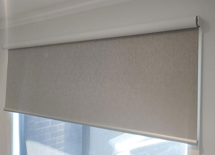 Under rolled roller blind with white fabric backing